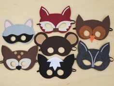 She sells these beautiful masks.  maybe we could make simpler ones.  Put together a kit & have boys assemble them?  Child Size Woodland Masks Pack by Mahalo on Etsy, $56.00
