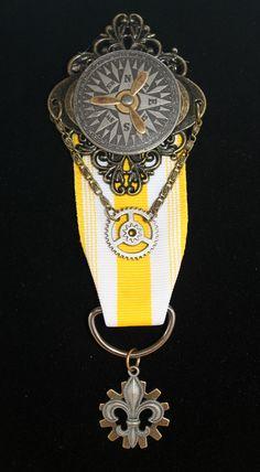 Steampunk badge- compass rose, propeller, fleur de lis, & gears