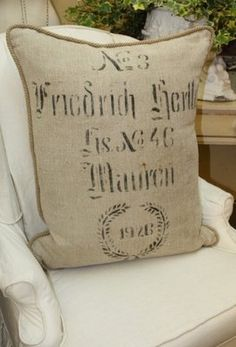 German grain sack pillow FYI- TJ Maxx has just put out some similar to these (actual burlap and rope trim) for less than 20 dollars