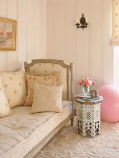 Antique daybed in the dressing room of Leslie Burke's 1920s five-bedroom Spanish Colonial Revival house; interior design by Kathryn M. Ireland #daybed #dressing_room #interior_design #side_table