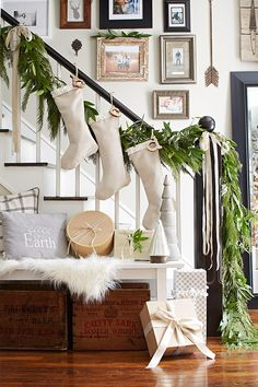 For a rustic farmhouse feel, skip the bright colors and sparkling accessories. Instead, opt for farmhouse Christmas stockings in neutral fabrics and simple textures. #christmasdecor #farmhousedecor #farmhousechristmasdecor #ideas #modernfarmhouse #bhg