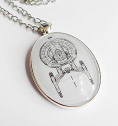 Star Trek Enterprise Diagram Glass Necklace. This will be mine. Probably soon. Resistance is...well, you know. :P