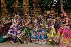 girls and women dress in the traditional garga choli, a three piece dress comprised of a colourful blouse, a long, embroidered skirt, and a shall known as a dupatta. photos are by amit dave and sam panthaky from ahmedabad, in the northern indian state of gujarat, where the garba dance originated.