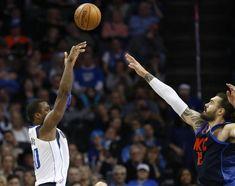 Dallas Mavericks forward Harrison Barnes, left, shoots over Oklahoma City Thunder center Steven Adams during the second half of an NBA basketball game in Oklahoma City, Sunday, Dec. 31, 2017. Dallas won 116-113. (AP Photo/Sue Ogrocki)