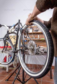 Real bicycle mechanic repairing custom bike. http://photodune.net/item/real-bicycle-mechanic-repairing-custom-fixie-bike/7278785