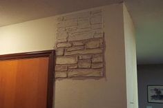 plain walls are transformed in to stone walls with joint compound, painting, wall decor