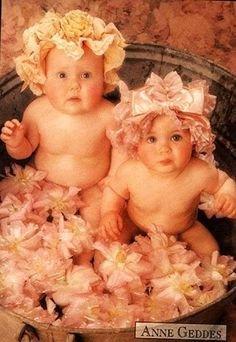 Anne Geddes~ I love her work!  I have a whole book of her baby poses!  So adorable!