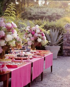 outdoors, with a pink theme, grand flower arrangements and lots of bite size desserts