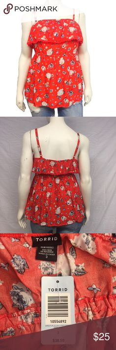 Torrid Ruffle Tank Torrid ruffle floral tank top! Beautiful warm weather top. Adjustable spaghetti straps. Babydoll style. Ruffle at the top. Stretchy. Easy, pull over the head style. A torrid size 3 is the equivalent of a 3X. New with tags, never worn. Smoke and pet free home. No damage, perfect condition. torrid Tops Tank Tops