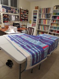 Jibberish Designs quilt studio  Instead of having a table for both sewing machines with attached gate legs, maybe it wouldn't be so bad setting up 2 extra folding tables when machine quilting.  might save a little on sewing room space.
