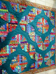 Mary's Curved log cabin, Kaffe Fassett fabrics. posted at Finely Finished Quilts.