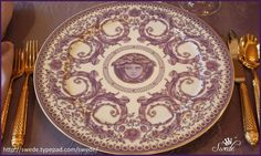 """The pattern is Grand Divertissement by Versace made in Germany by Rosenthal a great old porcelain firm. This is the charger at 13"""" diameter hosting """"Mr. Eyebrows"""" in the center. The other items in this pattern have different designs on them. Love the big swirls.  You can also see this pattern in the November/December 2012 issue of Victoria magazine on pages 28-33. The purple of the plates on those pages look much richer and darker than these are in person. As you can see in the  photos they…"""