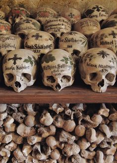 The skulls at the Chapel of St Michael in Hallstatt, Austria are famous for having been painted. The painted skulls are almost all male as they were outlived by their wives who would decorate them. Faber, Cemetery Art, Skull Painting, Danse Macabre, Catacombs, Suit Of Armor, Skull And Bones, Memento Mori, Skull Art