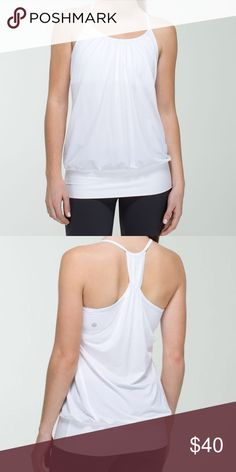 Lululemon No Limits Tank White Lululemon No Limits tank. Flowy racerback tank with soft band at bottom and built in sports bra. The fitted waistband is nice because this tank doesn't slide up and reveal your stomach during gym or yoga. True to Lululemon size 6 but could also fit a 4. lululemon athletica Tops Tank Tops