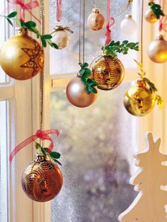 "Window decorations for Christmas do double-duty: they cheer you inside and out. Use some of these ideas to make your holiday windows sparkle! <a class=""g1-link g1-link-more"" href=""http://www.stylisheve.com/christmas-cheer-view-decorating-holiday-windows/"">More</a>"