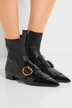 PRADA Buckled fringed leather ankle boots  $930.56 https://www.net-a-porter.com/product/743749
