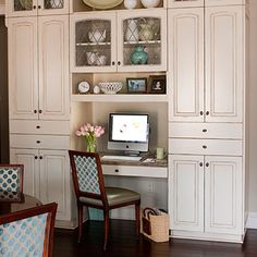 Ah! I LOVE this look. It actually made me gasp a little. Love, love, love it!! This would be totally possible to do if I took out the middle set of pantry's we are putting in and instead did a set of uppers and a desk. I so wanted a desk in the kitchen. Thank you Pinterest for the inspiration!!