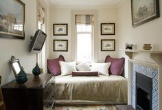 Studio ideas...bed is styled as a daybed, facing inward to the rest of the room.