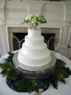 Silver Dish cake topper with fresh greens at the base