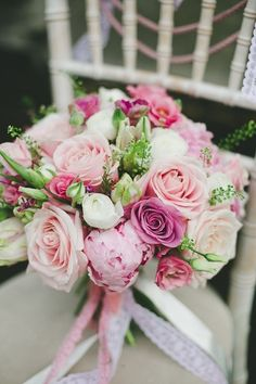 Dark pink roses, light pink roses of different sizes with purple peonies make stunning pink bridal bouquet