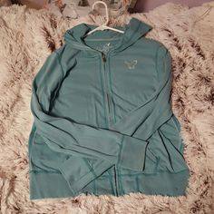 A Eagle Hoodie Light blue/teal American Eagle hoodie. The size says xl but it fits like a comfy large. It's in very good condition!! American Eagle Outfitters Tops Sweatshirts & Hoodies