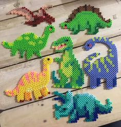 Cute dinosaur SVG cut file for girls compatible for silhouette cameo and circuit! They are perfect for card making, t-shirts and dinosaur themed birthday parties! About Dinosaurs are for Girls, Dinosaur SVG, Dinosaur Card, Dinos Perler Bead Designs, Perler Bead Templates, Hama Beads Design, Diy Perler Beads, Pearler Bead Patterns, Seed Bead Patterns, Perler Bead Art, Perler Patterns, Weaving Patterns