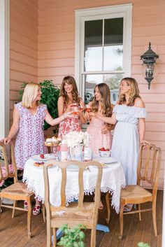 Last week my friend (and now neighbor!)Julia hosted a ladies Easter brunch on her adorable pink porch! And by porch...