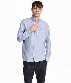 Light blue. Shirt in oxford-weave cotton fabric with a button-down collar, classic front, and open chest pocket. Long sleeves and cuffs with adjustable
