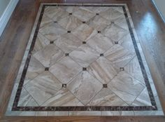 Great looking tile entry way, with granite accents, granite border, surrounded by hardwood. To learn more visit our website at www.capellinteriors.com