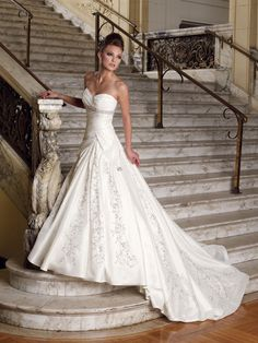 I like that this wedding dress has an empire waste and a sweetheart neckline even though it is fitted through the torso.