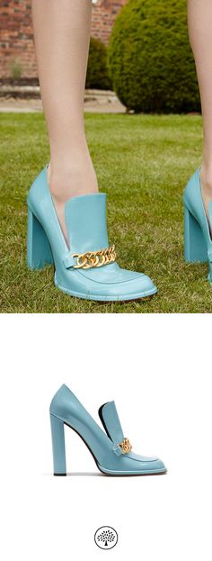 Shop the Regent Chain Loafer in Castle Blue Polished Calf Leather at Mulberry.com. A feminine take on the iconic loafer, the Regent Chain style features a handmade chain inspired by the detailing on the bear hats worn by Queen's Guards. The wide straight heel is complemented by a square toe shape and a classic loafer tongue covering the instep.
