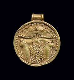 A CARTHAGINIAN GOLD PENDANT CIRCA 7TH-6TH CENTURY B.C. The embossed sheet disk embellished on one side with filigree and granulation, with a winged solar disk above uraei flanking a granulated omphalos topped with a horned solar disk, all within a raised border, with a ribbed tubular suspension loop