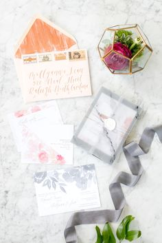 Mikkel Paige Photography pictures from a Merrimon-Wynne House wedding in Raleigh, NC. Photo of their invitation suite. Stationery designed by One and Only Paper. Calligraphy by Quietude Co. Palette of pink, grey, white and marble and floral patterns.