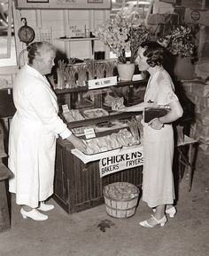 Shopping for groceries, 1930s.