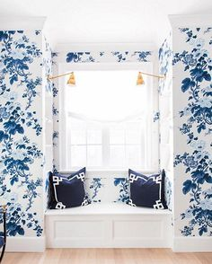 This blue and white floral wallpapered window seat is so special!