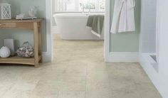 Cozy Emser tile floor with white baseboard and oak bath furniture plus cozy soaking tubs for modern bathroom design Vinyl Flooring Bathroom, Bathroom Vinyl, Stone Bathroom, Bathroom Floor Tiles, Bathroom Ideas, Master Bathroom, Tile Bathrooms, Cream Bathroom, Tub Tile