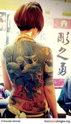 WOW, gorgeous but how long did this take! yikes! Girl with a full-back dolphin tattoo
