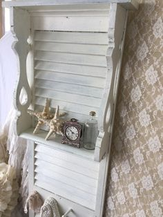 This fabulous old wooden shutter has been made into a display rack with hooks! This would make an excellent addition to your shabby romantic