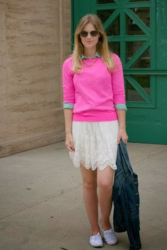Whit styles a hot pink sweater and lace skirt