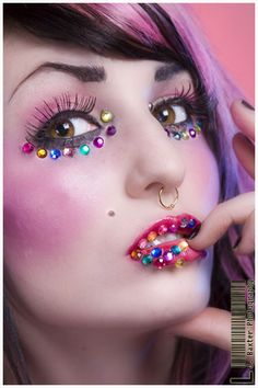 A rainbow of crystals accent pretty pink make-up.