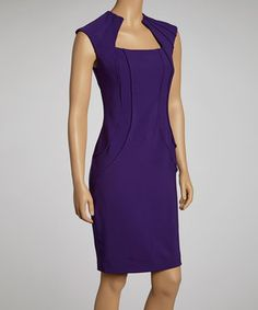 An elegant cap-sleeve dress gets a contemporary update with contoured seam detailing and a distinctive neckline. The rich plum hue adds an extra boost of style.