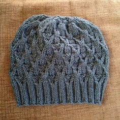 This fun hat uses twisted stitches to create a lot of textural interest. To knit it, you'll need about 150 yards of worsted weight yarn, a circular needle in size one in size and a set of double pointed needles, also in size Baby Knitting Patterns, Knitting Designs, Knitting Projects, Piercings, Knit Beanie Pattern, Knitting For Charity, Cable Knit Hat, Moda Emo, Man Fashion