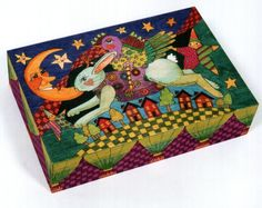 Helen Heins Peterson uses colored pencils for one-of-a-kind works of art.  I have one box she did, and love it!