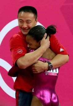 Gabrielle Douglas of the United States hugs her coach Liang Chow after the floor exercise in the Artistic Gymnastics Women's Individual All-Around final on Day 6 of the London 2012 Olympic Games at North Greenwich Arena on August 2, 2012 in London, England. (Photo by Ronald Martinez/Getty Images)