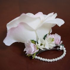 Pretty White and Pink Large Flower Barrette nestled with Small Petite Flowers and a Pearl Chain for an extra special touch of elegance and class