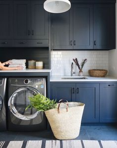 Laundry! Love this layout. Doors in front of machines.  Design by Kate Marker Interiors