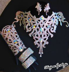 Ballroom jewelry, statement Swarovski Crystal jewelry accompanied by bracelets and earrings made with Swarovski Crystals, designed and created by Sonja Ballin. All Jewelry Designs copyright ©2014, Sonja Ballin of Tampa Bay, Florida.  www.sonjadesigns.com Check us out  (and like) on Facebook:  https://www.facebook.com/pages/Designs-By-Sonja/220737151285770