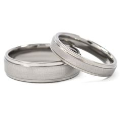 Wedding on a budget? New His And Hers Wedding Band Set Titanium by RenaissanceJewelry from Etsy. $49.99