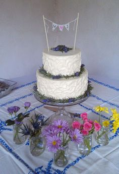 Rustic 2-tier wedding cake accented with wildflowers, rosemary, and lavender by Cherron K.