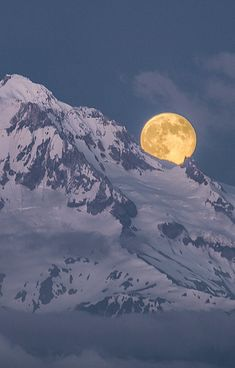 Mountain moonrise. Would love to watch this from a hot tub on the deck of a ski chalet.